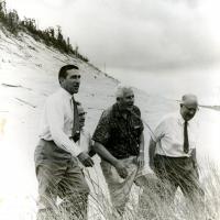 Stewart Udall, Senator Bible, Senator Douglas, and Conrad Wirth touring the Indiana Dunes, 1961.