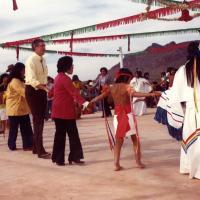 Udall with Tohono O'odham dancers. 1978.