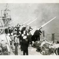 Sailors Running Gun Firing Drills on Deck of USS Arizona