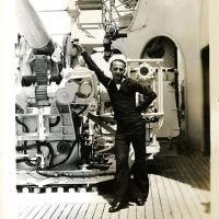Sailor Posing with Anti-Aircraft Gun