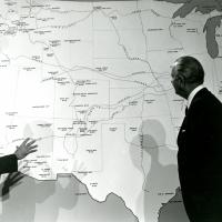 Signing of the National Trails Bill, October 2, 1968. Photo credit: U.S. Department of the Interior. President Johnson looking at a large map with Udall.