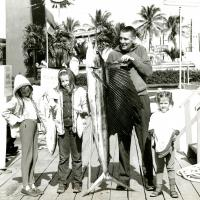 Mo and family with a swordfish, Miami, Florida, 1960s