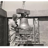 Lowering the Arizona's bell into position