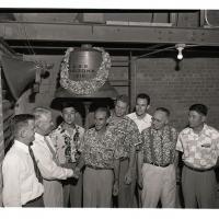 Hawaiian team hangs wreath on USS Arizona Bell