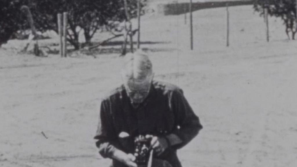A.E. Douglass with movie camera, 1920s.