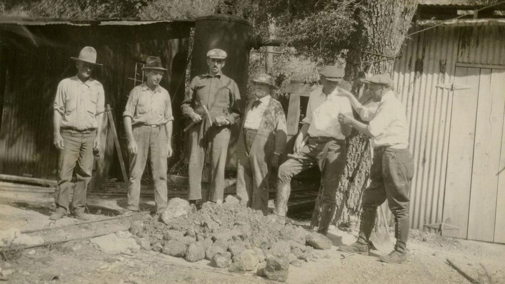 Photograph from Morning Glory Mine of Miners Surrounding Ore, circa 1920-1932