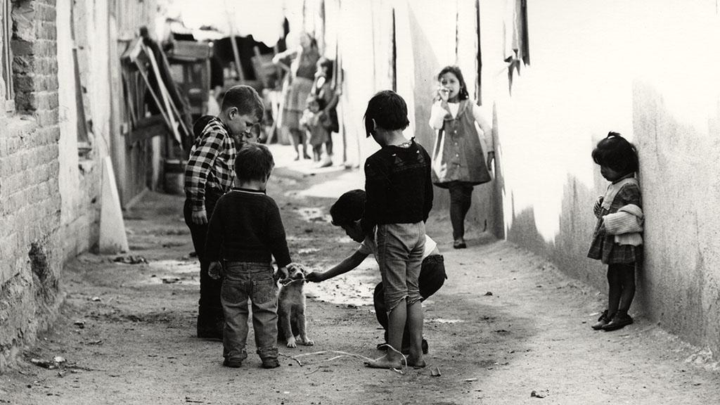 Photograph of Children Playing With a Dog in an Alley, Nogales, Sonora, 1968