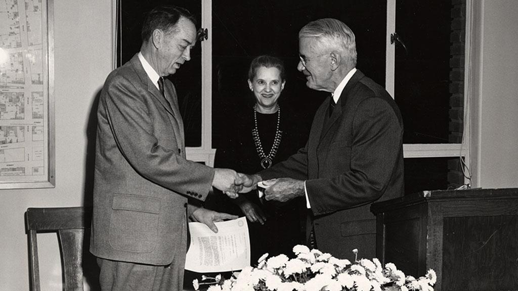 Photograph of Dr. Rudolph H. Gjelsness Receiving Medal of Merit, 1960
