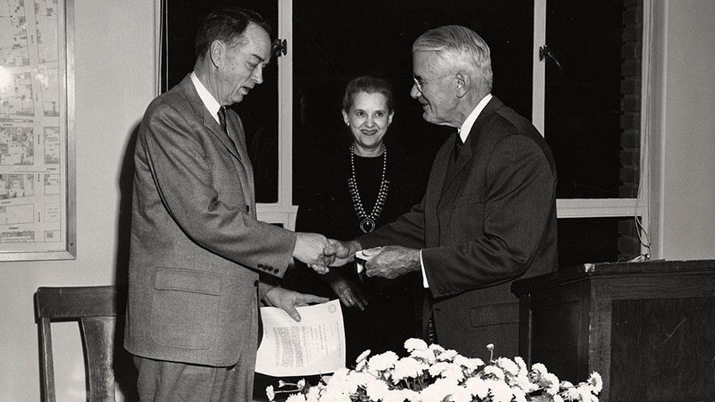 Photograph of Dr. Rudolph H. Gjelsness Receiving Medal of Merit, 1960