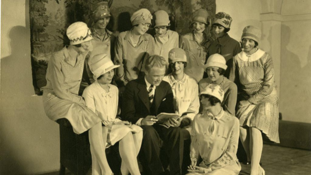 Girls Gathered Around Man Reading