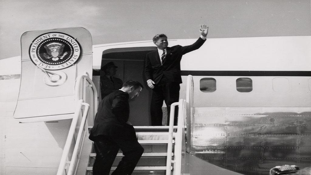 Photograph of John F. Kennedy and Stewart Udall on Airplane, circa 1961
