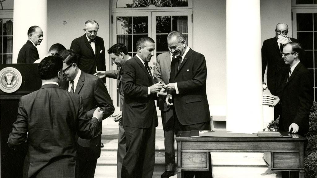 President Lyndon Johnson Handing Secretary Stewart Udall a Pen