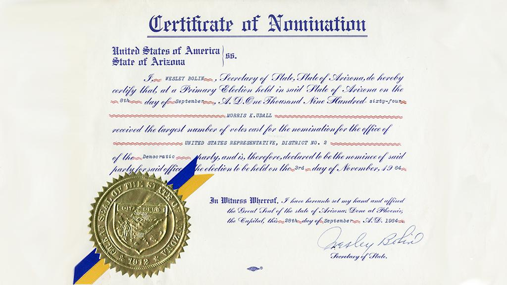 Certificate with text and gold seal with blue and yellow ribbon.