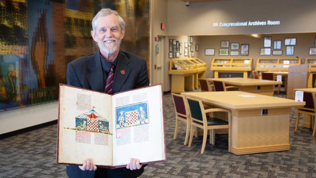 Albrecht Classen holding a book