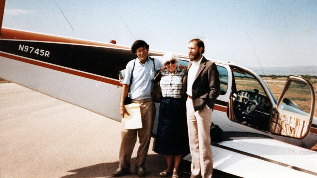 Three People Standing in front of Crashed Airplane, 1986