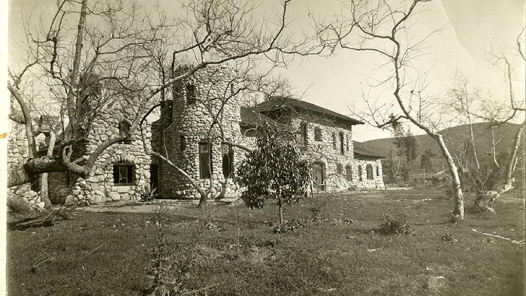 black and white photo of a large stone house