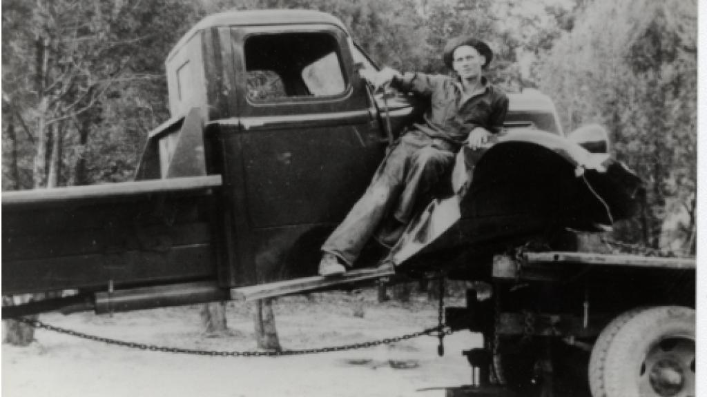 Unidentified Man Posing on Truck, undated