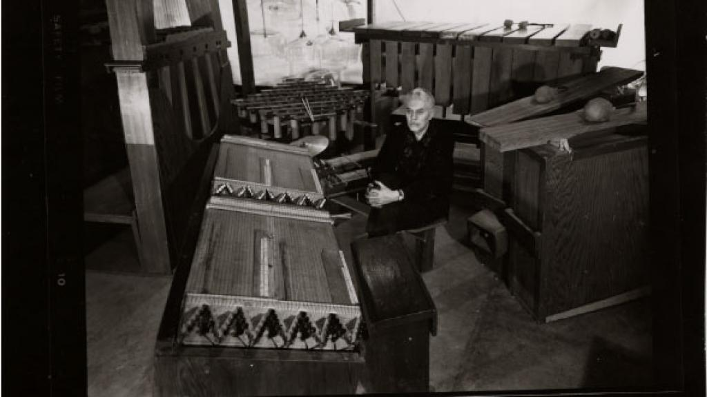 Photograph of Harry Partch Surrounded by His Hand Made Instruments, undated