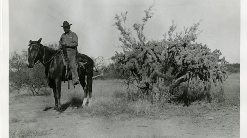 W.J. McGee on Horesback in the Desert