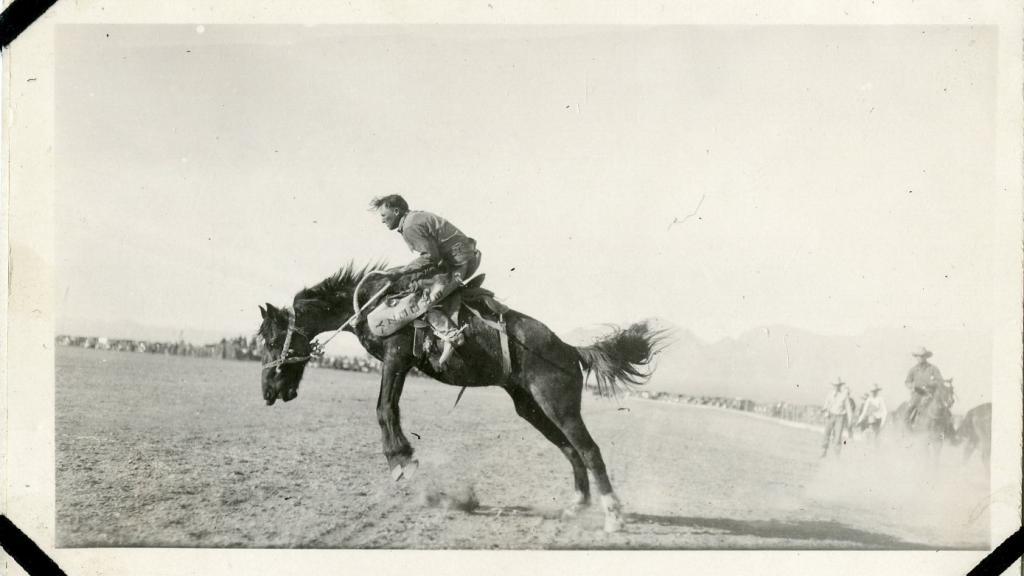Man Riding Bucking Bronco