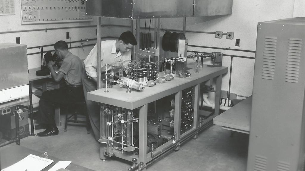 laboratory with two men working with microscopes and equipment