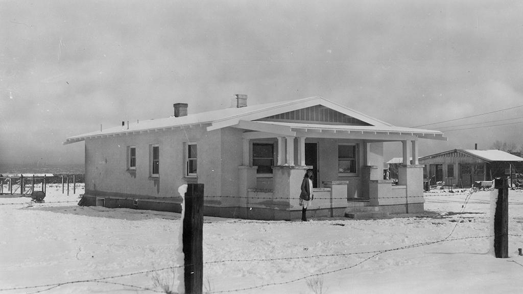 Meta Pape, daughter of Otto Pape, stands in front of their Tucson home in the snow, March 12, 1922
