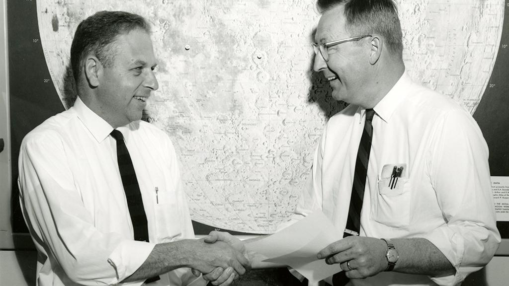Charles Sonett (left) shaking hands, circa 1969